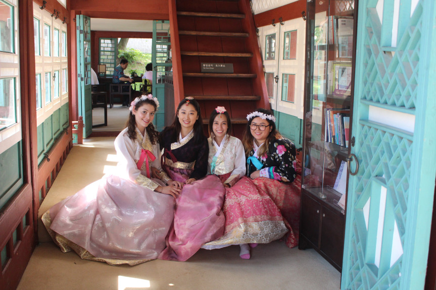 CSUF titans wearing hanboks (Korean traditional dresses) while studying abroad in South Korea.
